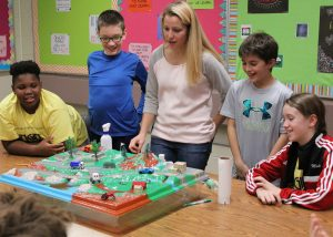 Each student demonstrated how a different kind of pollution entered the environment and accumulated in the local water supply.
