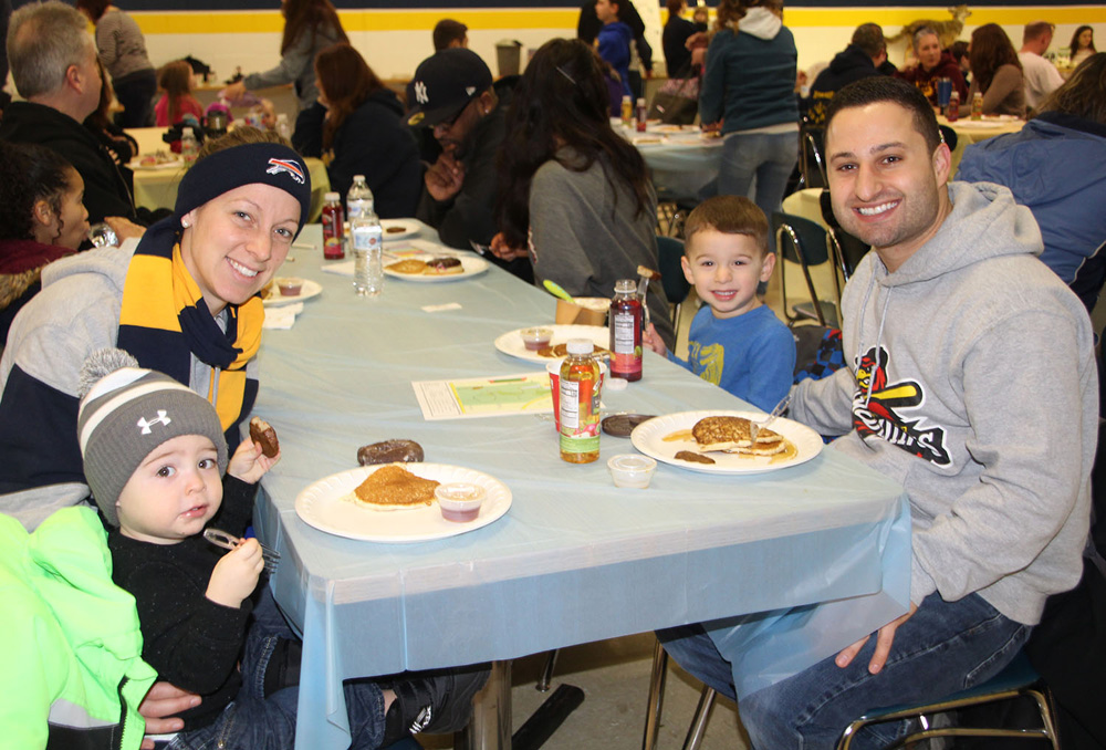 Nature Center Committee Chair and Cosgrove Assistant Principal, Tracey D'Alonzo, enjoyed the pancake breakfast with her family in 2019.