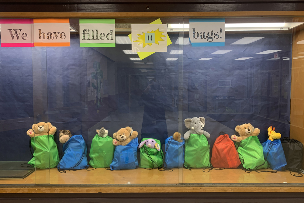 Completed bags are added to a display case to tally of project progress. Photo by Betsy Brown