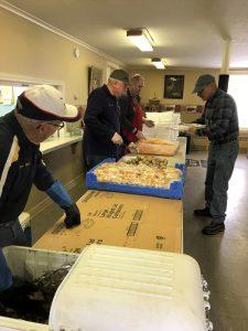 Lions Bob Furness, Dan Peckham, and Randy Unterborn prepare the dinners along with Greg Speer.