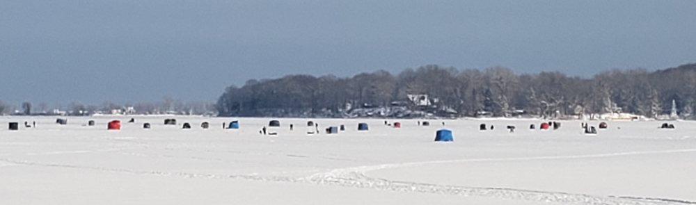 Even with this large number of ice fishermen on Sodus Bay Sunday, February 9, a father and his young son went through the ice. If it wasn't for the heroic first responders from the Alton Fire Department, the father could have lost his life.