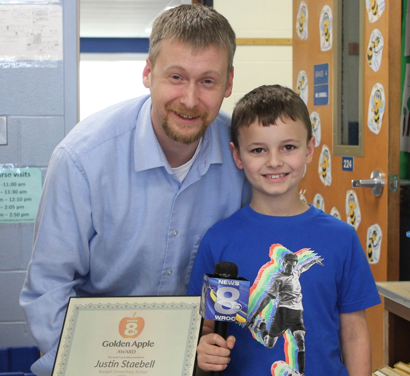 Kendall teacher Justin Staebell with Anthony Seymour, the student who nominated him for the Golden Apple Award.