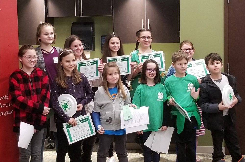 4-H youth received a certificate and positive feedback for the presentations they created. Photo by Mike Dondorfer.