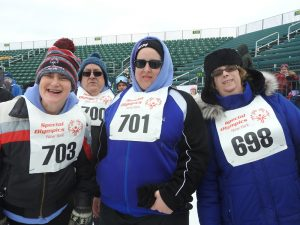 L-R: Patricia Van Savage, Kerri Patrick and Michelle Markham waiting for the next race. Van Savage has been a participant in the Special Olympics for 45 years.