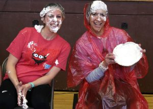 PE teacher Bethany Matsko (l) and Assistant Principal Renee Mulrooney (r) wear their whipped cream with pride.