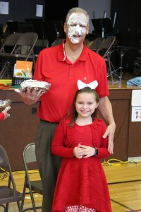 Principal Dave Johnson with his daring student pie thrower Ava.