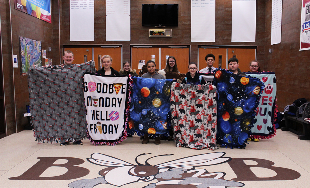Liberty Scholar participants display their completed blankets. Photo by Gretchen Spittler