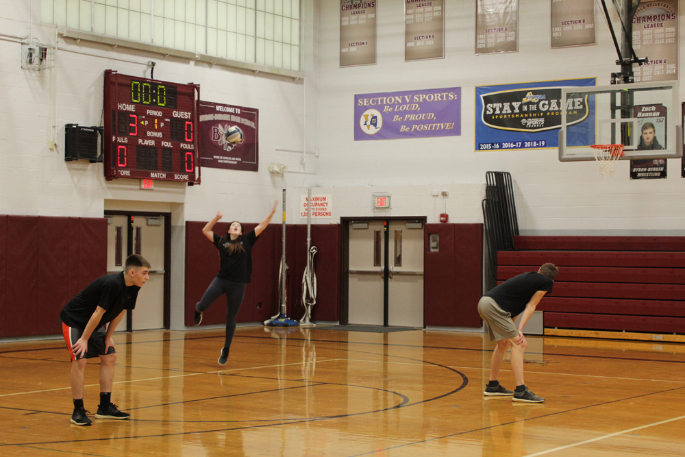 Abby Vurraro serves during students versus faculty volleyball game. Photo by Gretchen Spittler.