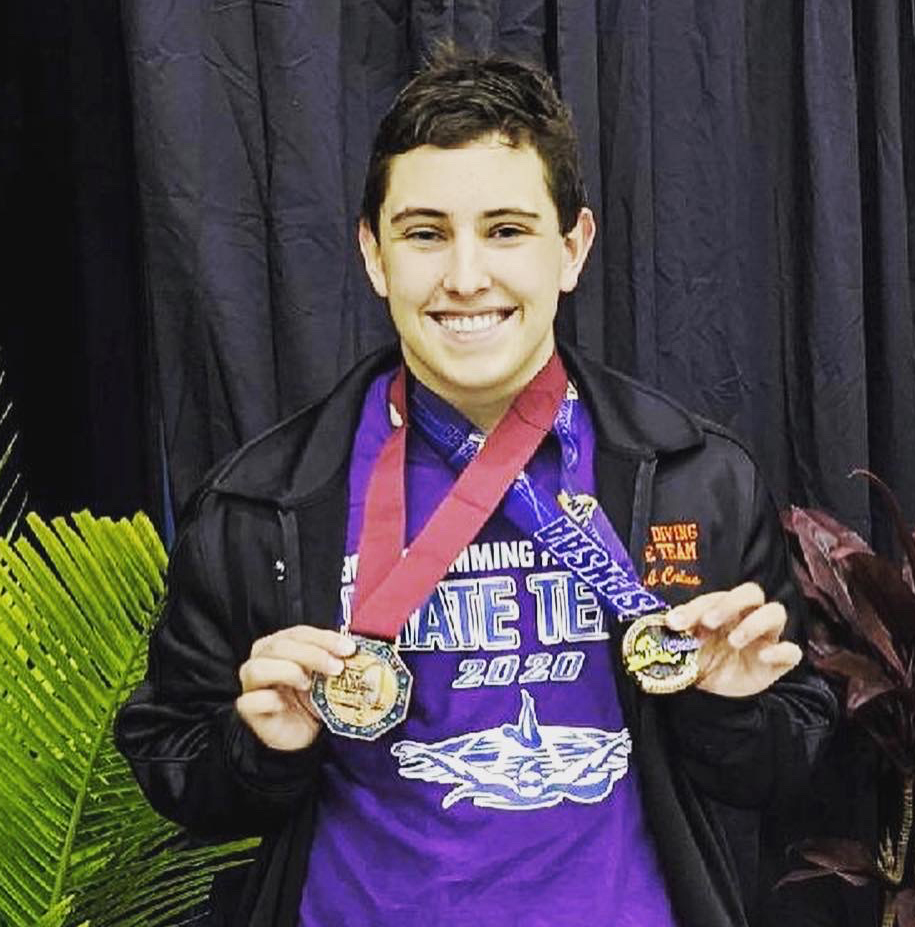 Jacob Calus displays the medals he received for his ninth place finish at the state championship in March.